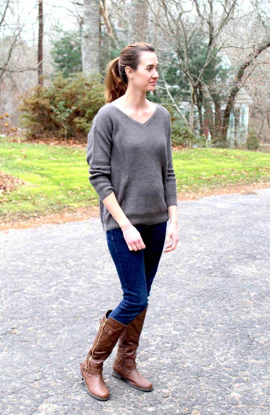 Oversized sweaters are everywhere, and are great for accomodating or hiding the first trimester bump #maternityoutfit #pregnancyfashion