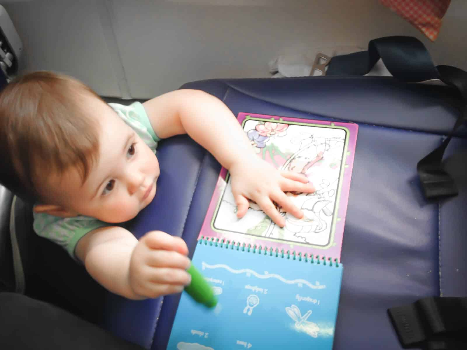 Realities of Traveling With a Toddler On a Plane (+ Crew Member Tips to Make it Easier)