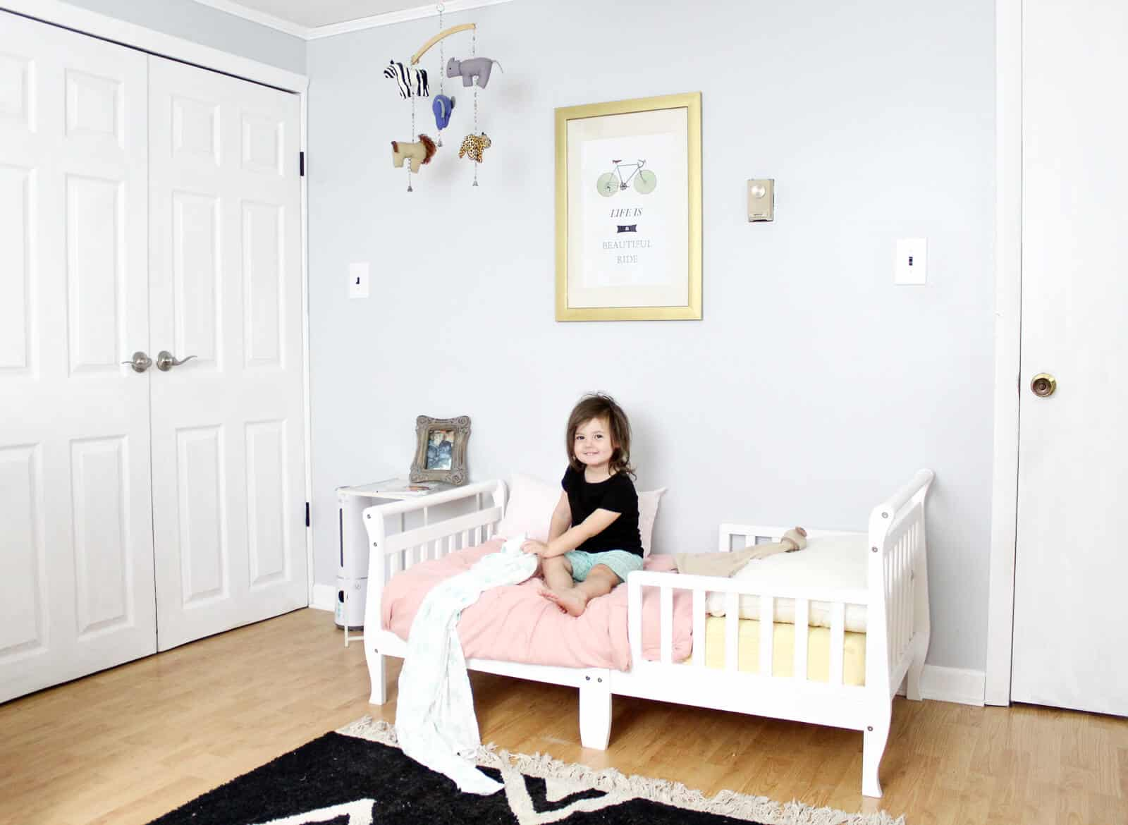 A sweet and minimal modern + classic baby girl nursery (shared infant & toddler room) with easy decor ideas. | Nursery Themes | Nursery Decor | #nursery #babynursery #babygirlnursery #toddlerroom #kidsroom