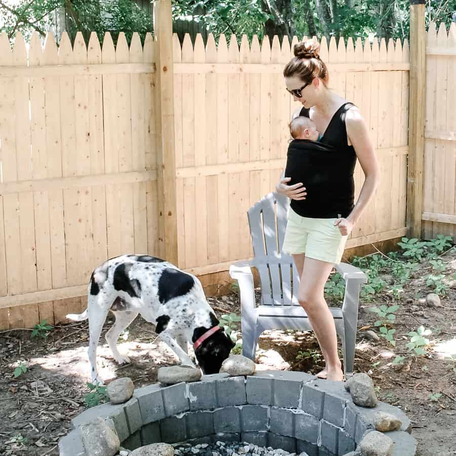 Mom with baby in Lalabu Soothe Shirt with dog outside