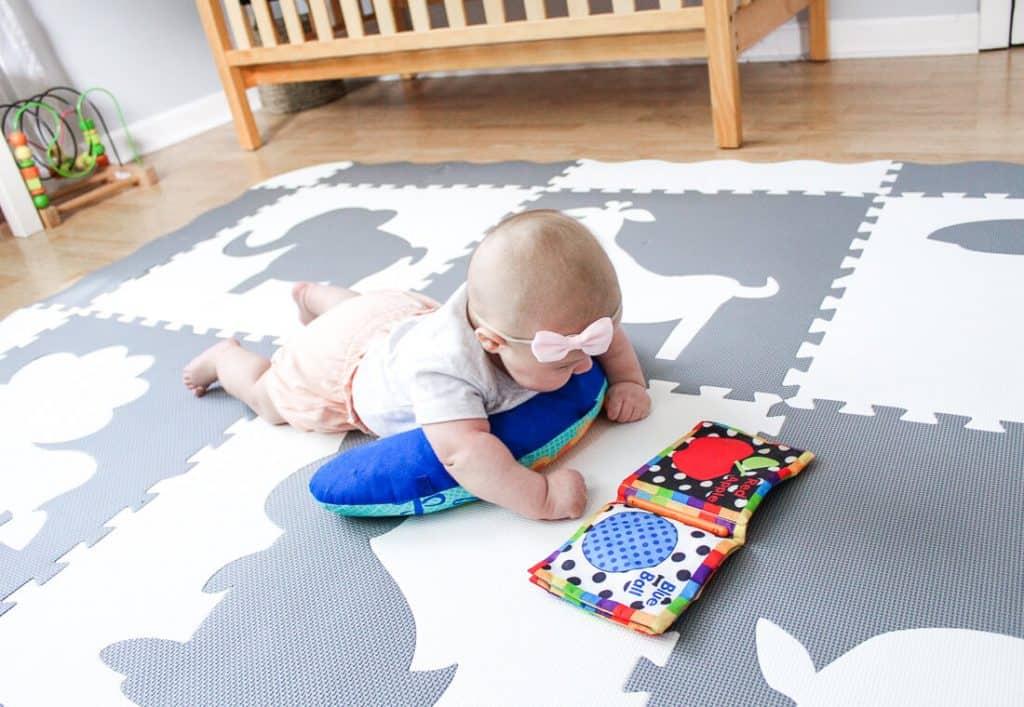newborn baby on foam play mat tiles